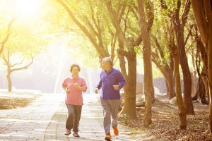 Elderly couple jogging in the park