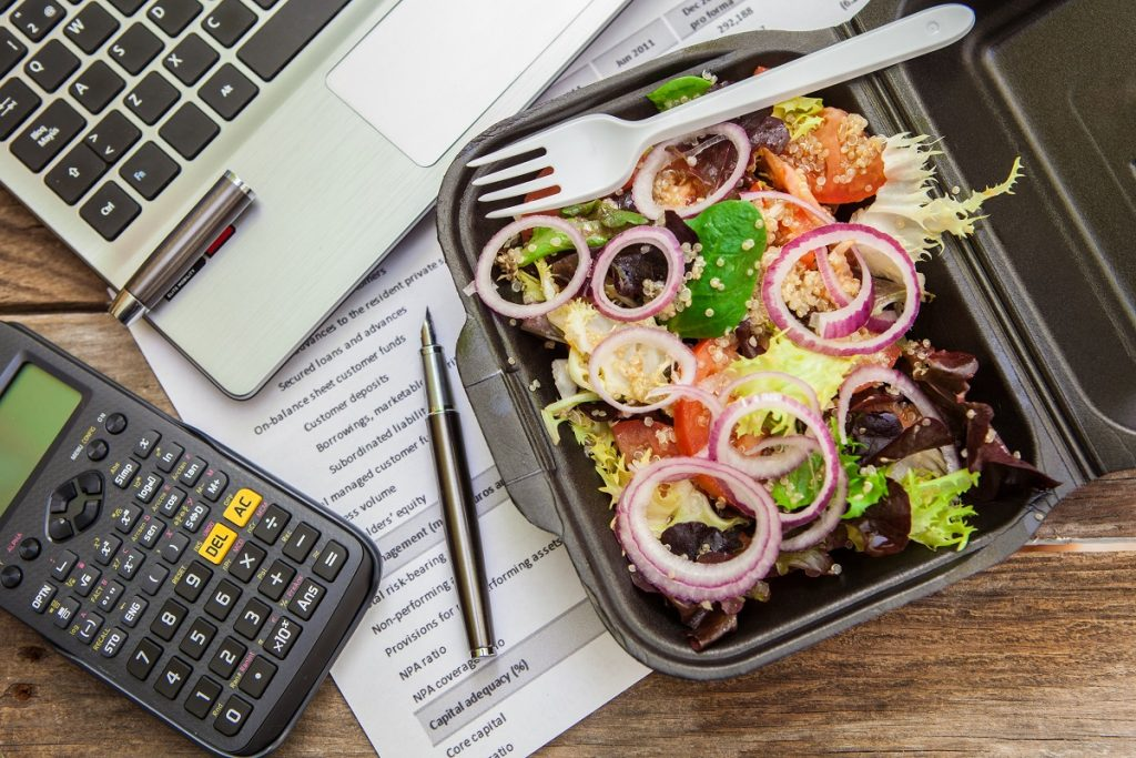Packed meal beside a calculator