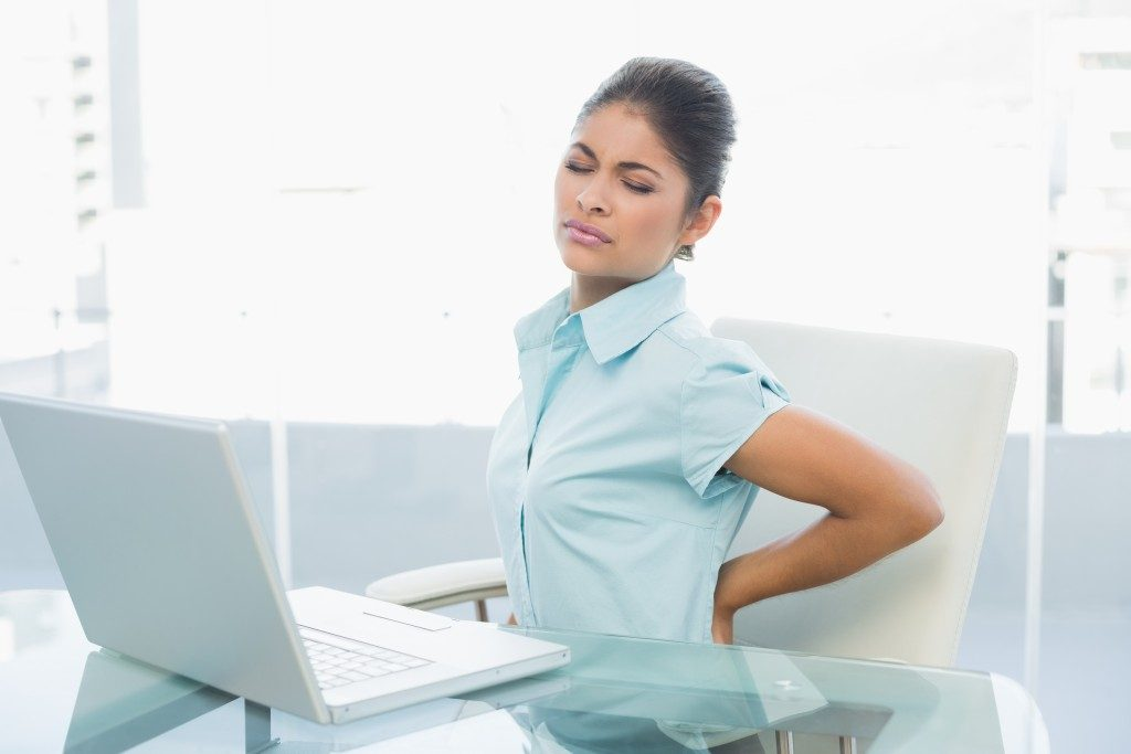 Woman with a back pain at work
