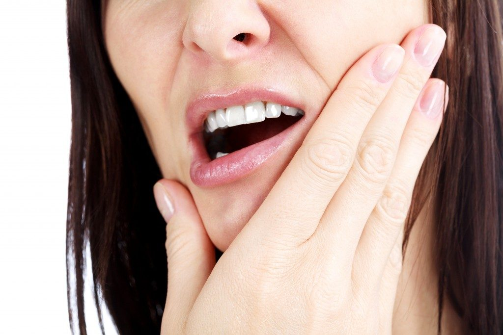 Woman with growing wisdom tooth
