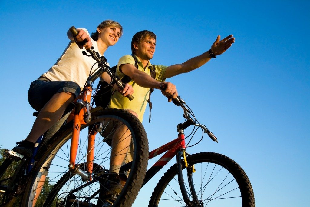 man and woman on their bikes