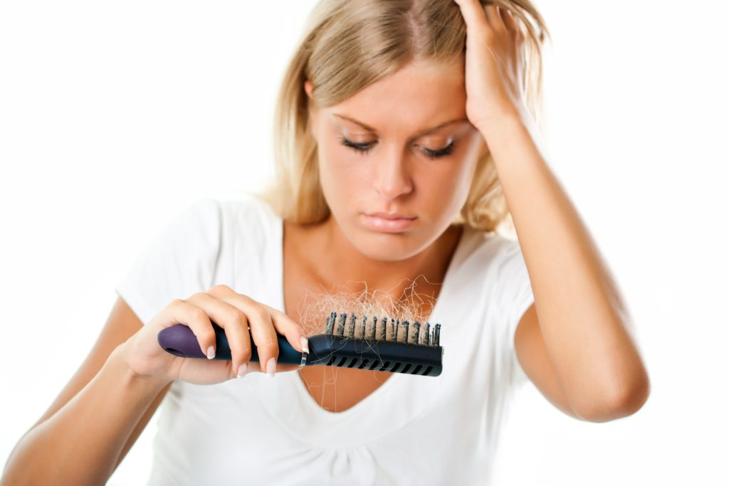 a woman worried about hair loss