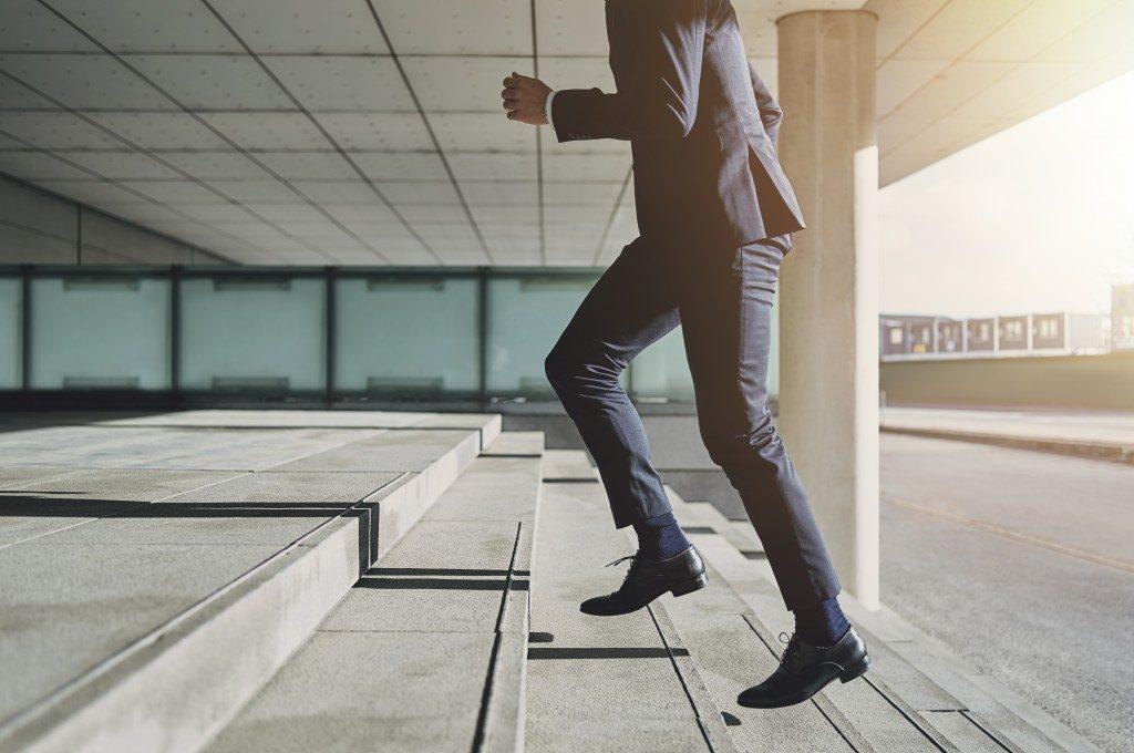 Businessman running upstairs