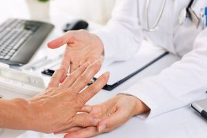 person getting assessed for arthritis