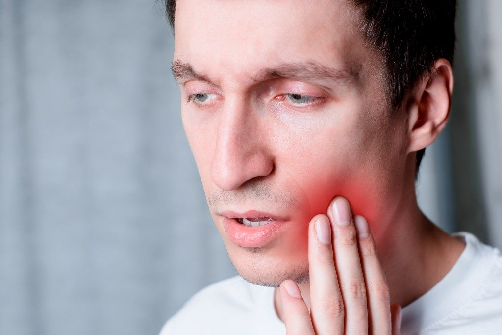 man having a tooth pain