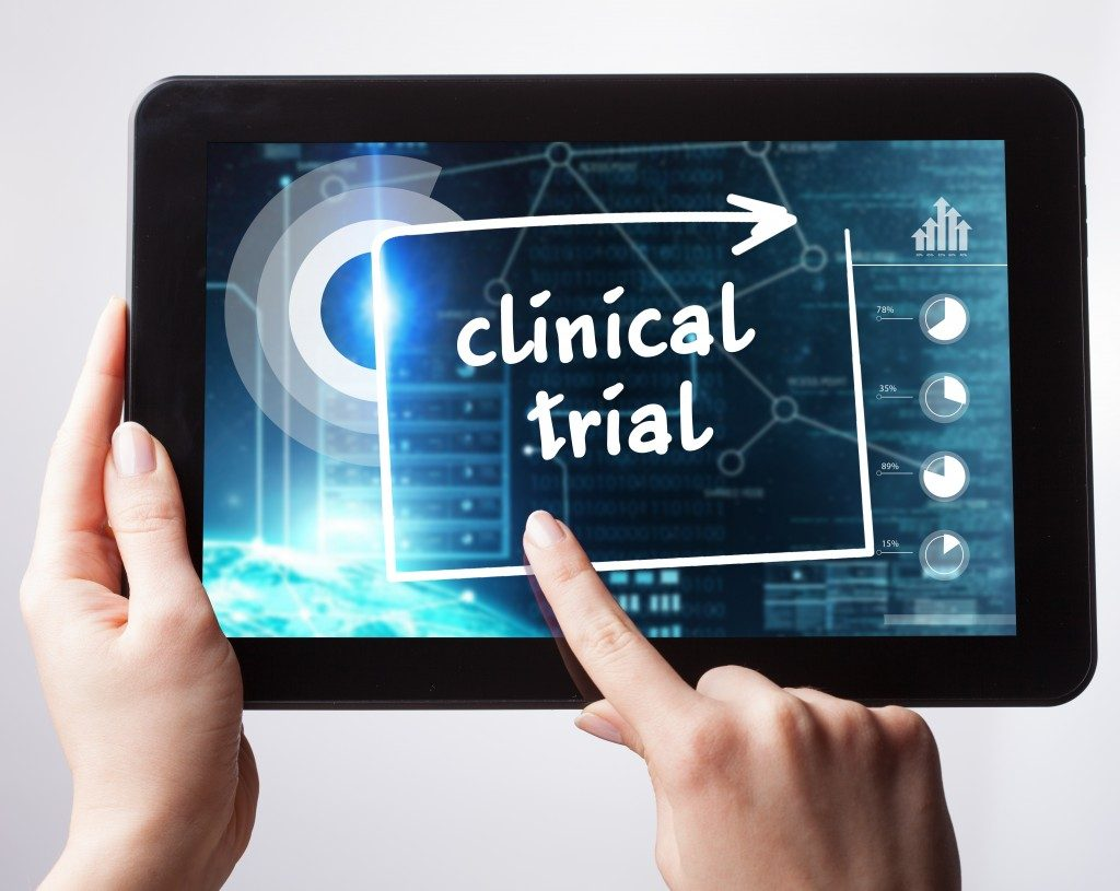 person tapping on clinical trial concept on tablet