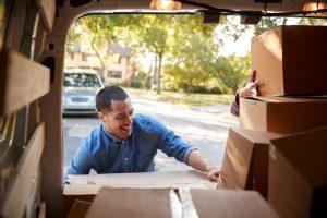 man loading boxes in van