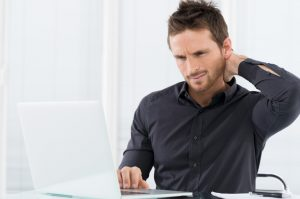 Man overworked with a hurting neck