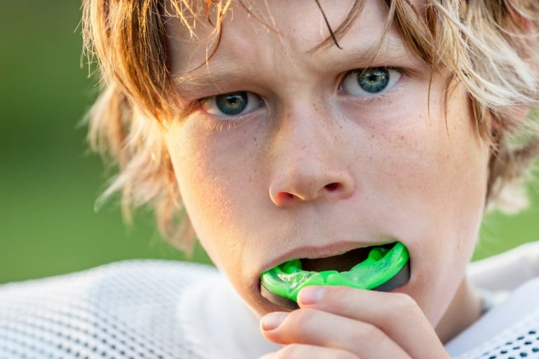 kid with mouthguard for sports