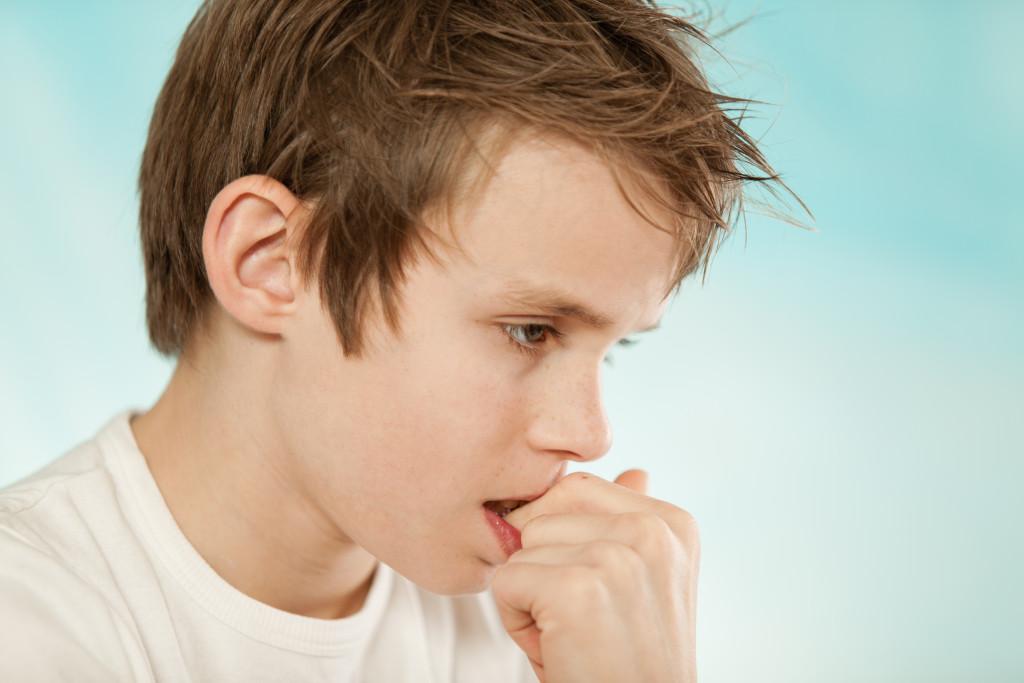 Boy biting nails