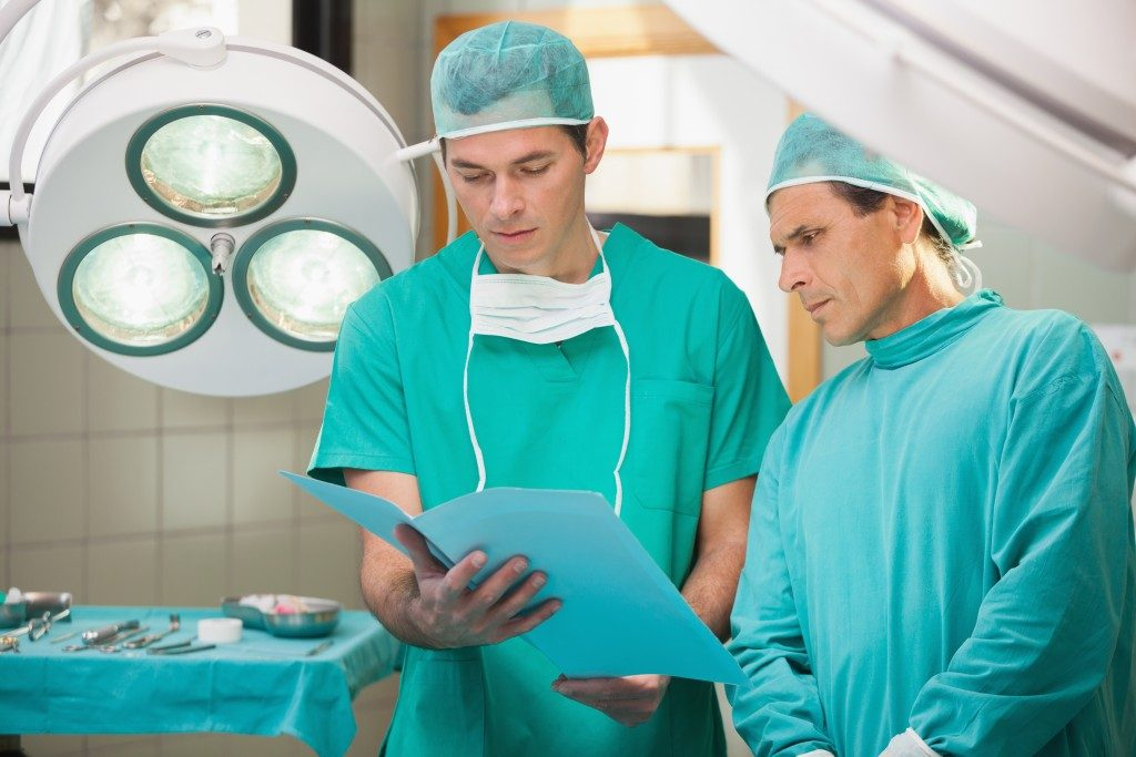 surgeons looking at patient file