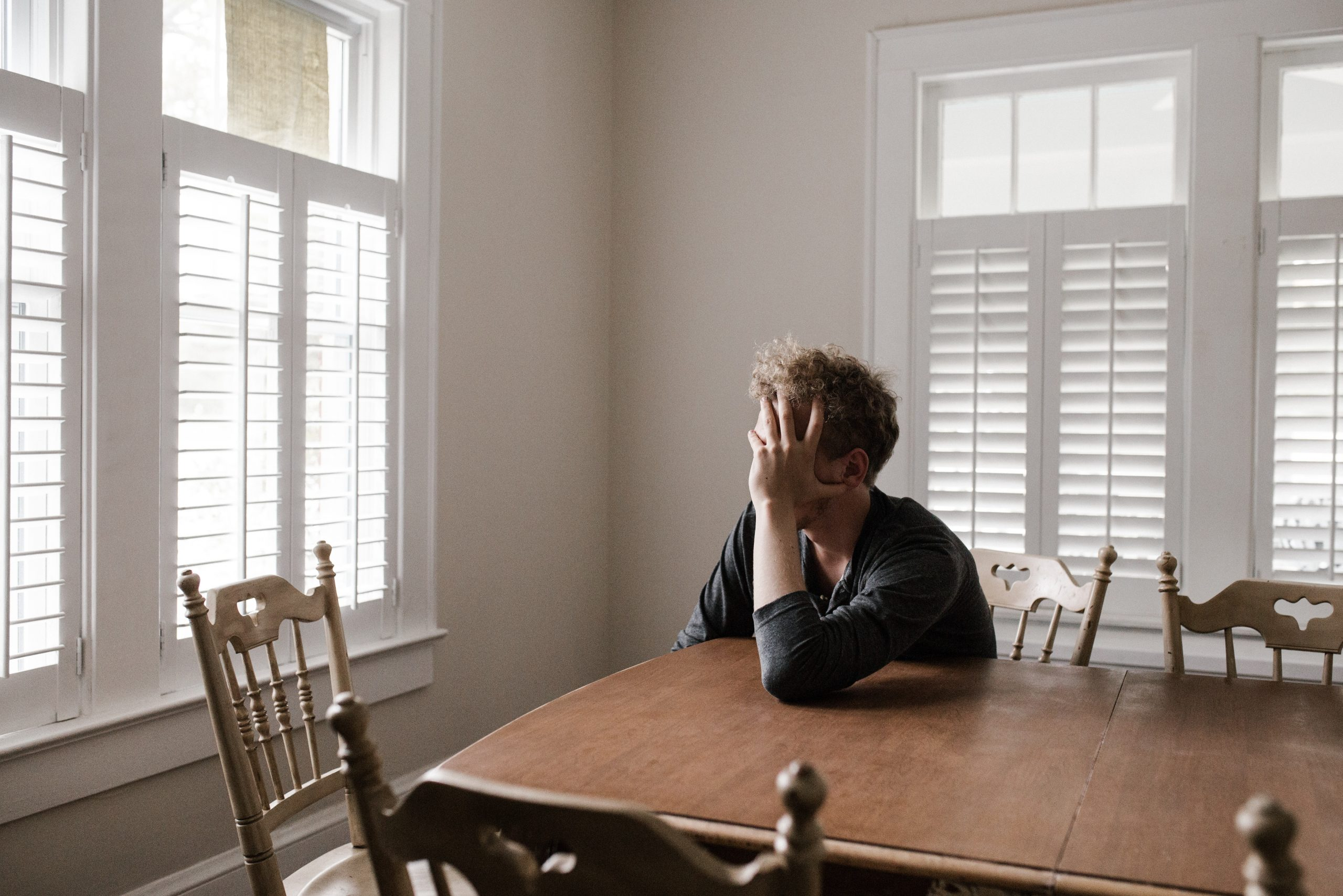 man feeling anxious at home