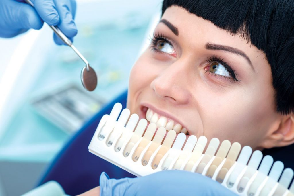 woman getting work done on her teeth