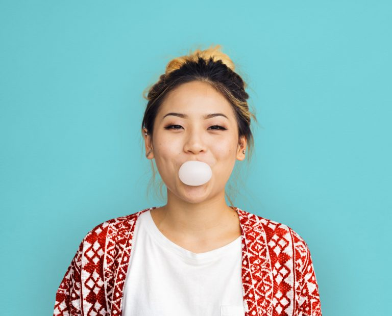 woman blowing bubble gum